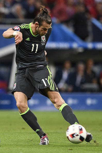 #EURO2016 Wales' forward Gareth Bale shoots the ball during the Euro 2016 semifinal football match between Portugal and Wales at the Parc Olympique Lyonnais...