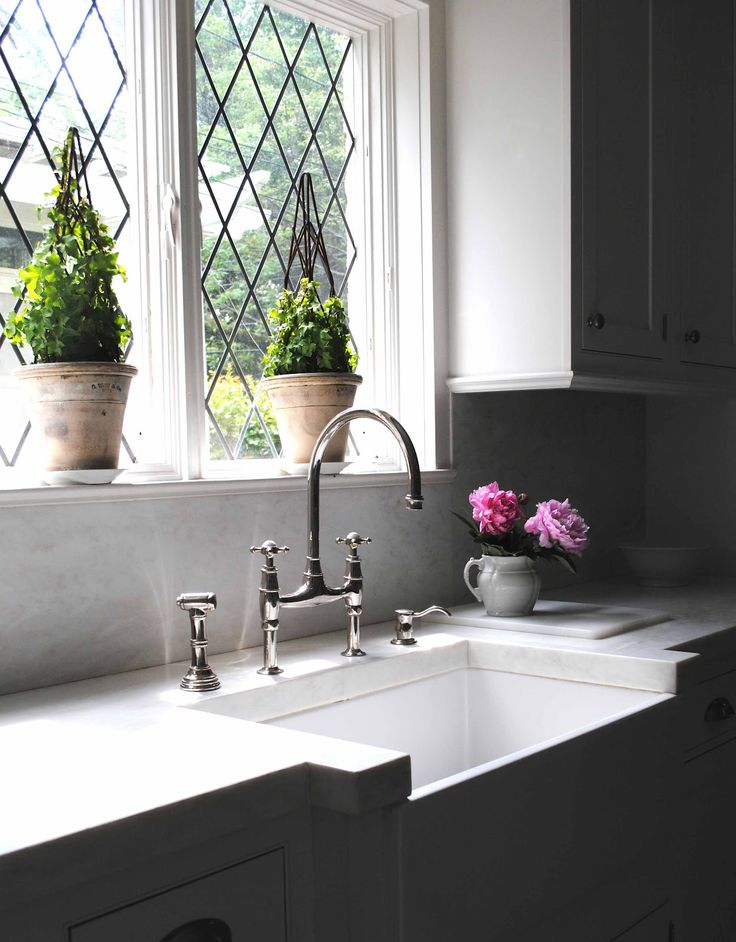 Tone on Tone: thick marble countertops, leaded glass windows, bridge faucet