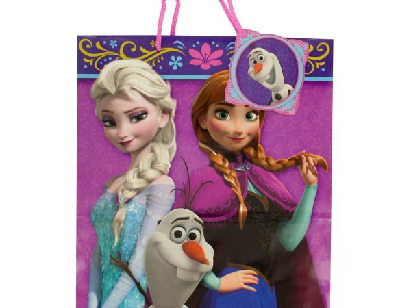 """Disney's Frozen Gift Bag, 108 - Make little girls smile with this fun Disney's Frozen Gift Bag featuring Frozen graphics and decorative floral borders on a glossy paper bag with pink nylon handles and a matching die cut gift tag. Measures approximately 13"""" x 10.5"""". Comes loose with a hang tag.-Weight: 0.1694/unit"""