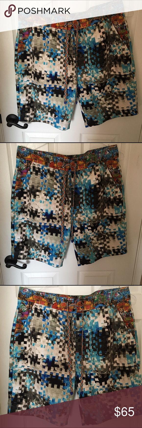 Robert Graham men's bathing suit size 36 Robert Graham men's bathing suit in perfect condition. Worn once and hand washed. Signature RG styling and details. Fun pattern soft silky material. Size 36 but Run on the smaller size Robert Graham Shorts Hybrids