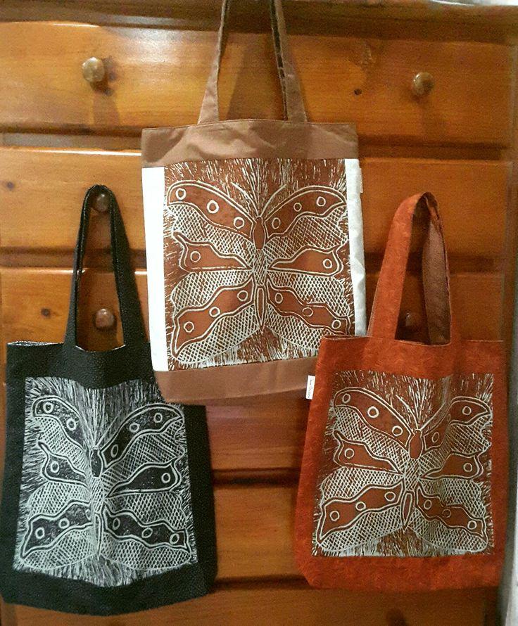 Tote bags featuring Maningrida print fabric.