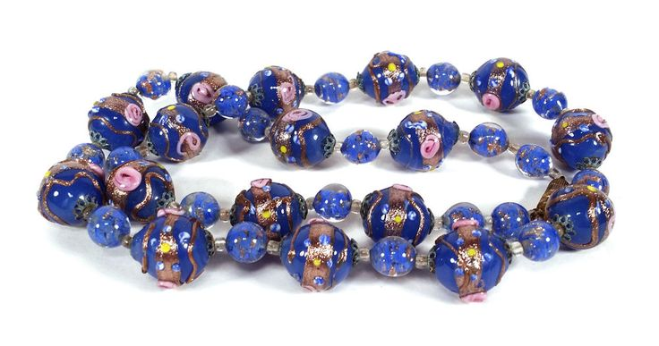 This necklace consists of 17 large glass multicolored wedding cake style beads, with medium blue glass beads that have internal copper aventurine decoration. There also are small, clear spacer beads. | eBay!