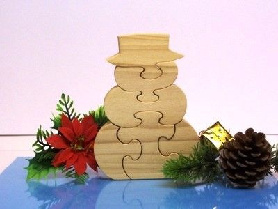 """This is a snowman wooden puzzle. This puzzle will stand up or lay flat on both sides. Children love putting together wooden puzzles. Puzzles help promote manual dexterity.The puzzle also can be used as a ornament.The picture of the one listed here just sold recently. I will make a duplicate one just like it with your purchase. This puzzle measures 4W x 5 1/2H x ¾"""" thick and is made of poplar wood. A child safe non-toxic finish has been applied. All items listed in my shop are guaranteed…"""