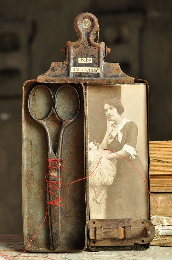 an aged, rusty display with clipboard and scissors