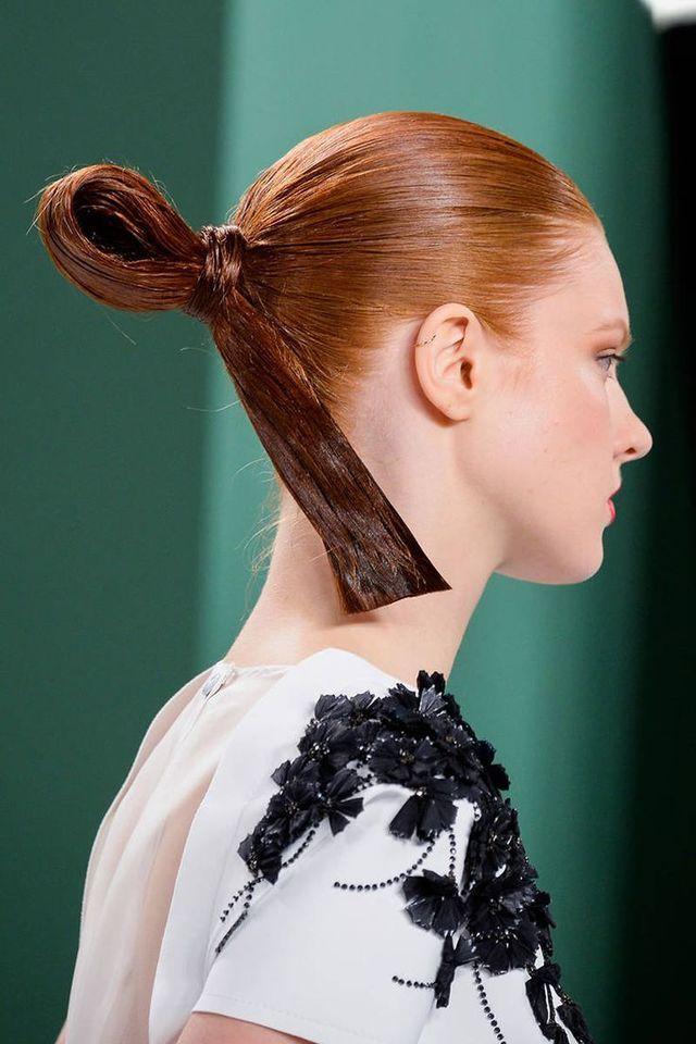 スプレーやジェルでがっちりまとめられた斬新なお相撲さんヘアーは強風時にもぴくともしません。