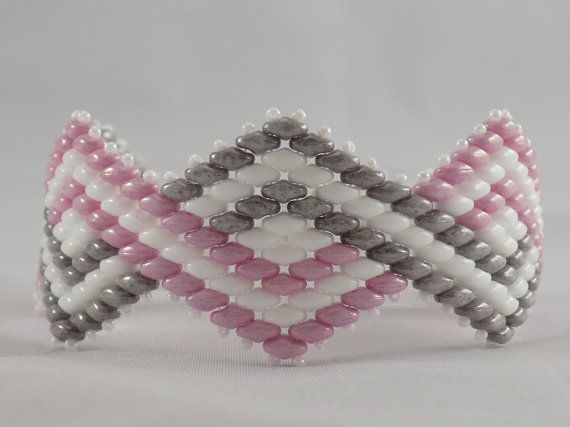 Hey, I found this really awesome Etsy listing at https://www.etsy.com/listing/213012749/pink-grey-and-white-super-duo-beaded