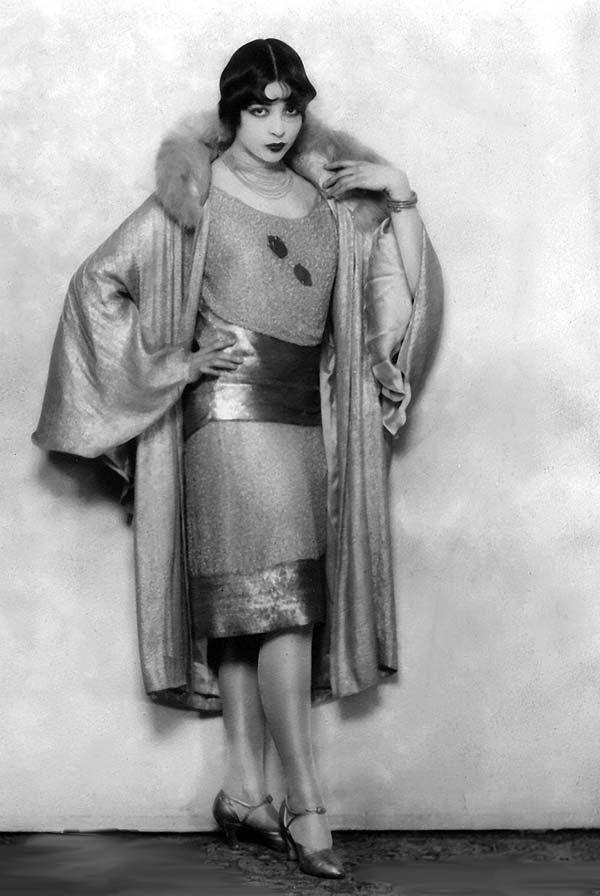 1920s Fashion - those heels were definitely made to show off that hemline - the coat too.   Flapper mentality - I'm gorgeous, and I know it
