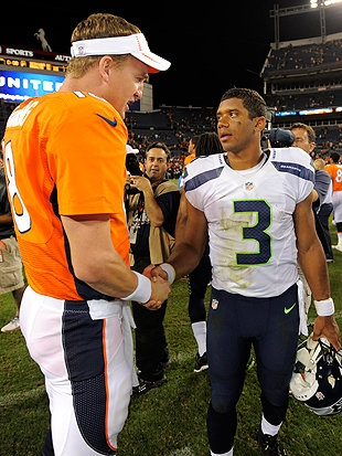 Russell Wilson talks to Peyton Manning after Seattle's 30-10 preseason win over the Denver Broncos. #yahoo