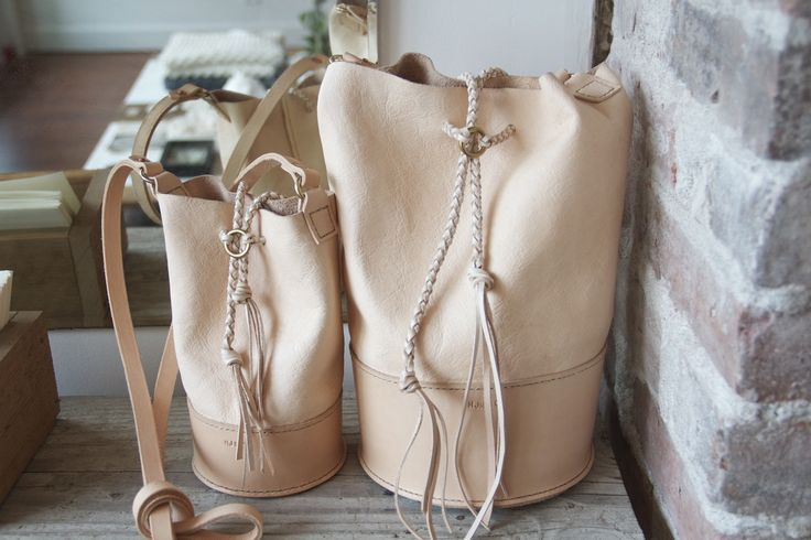 HJN Leather Craft Co. veg tan hand-stitched ditty bags with braided leather.  Original design by Hannah J. Newton. #leather #dittybag #handbag #bags #handmade