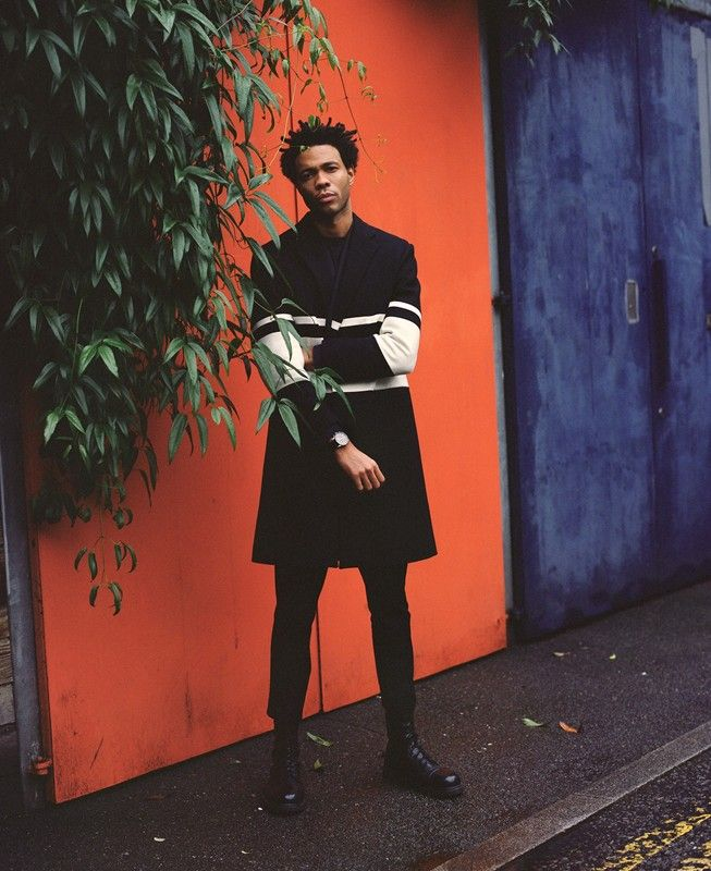 Charlie Casely-Hayford wears coat by Casely-Hayford AW14 and Sentry watch from Nixon's holiday 2014 collection