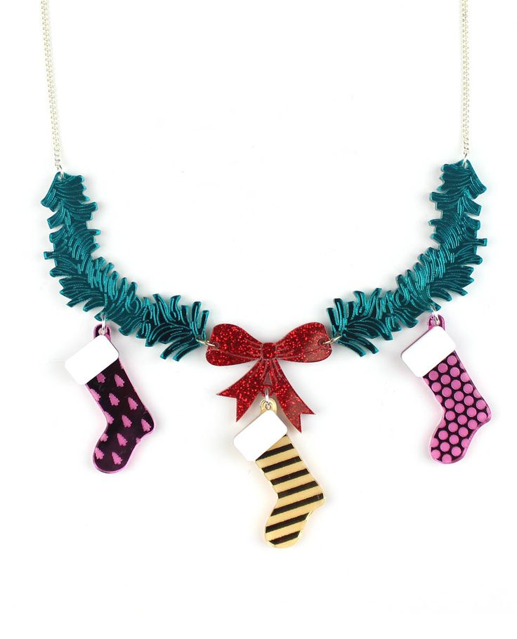Christmas stocking necklace, We must hurry and hang the stockings on the mantelpiece so that Santa can leave his presents. These multiple colored stockings dangle form a ribboned wreath placed on top of the fireplace. If you've been good this year, you will receive plenty of presents.