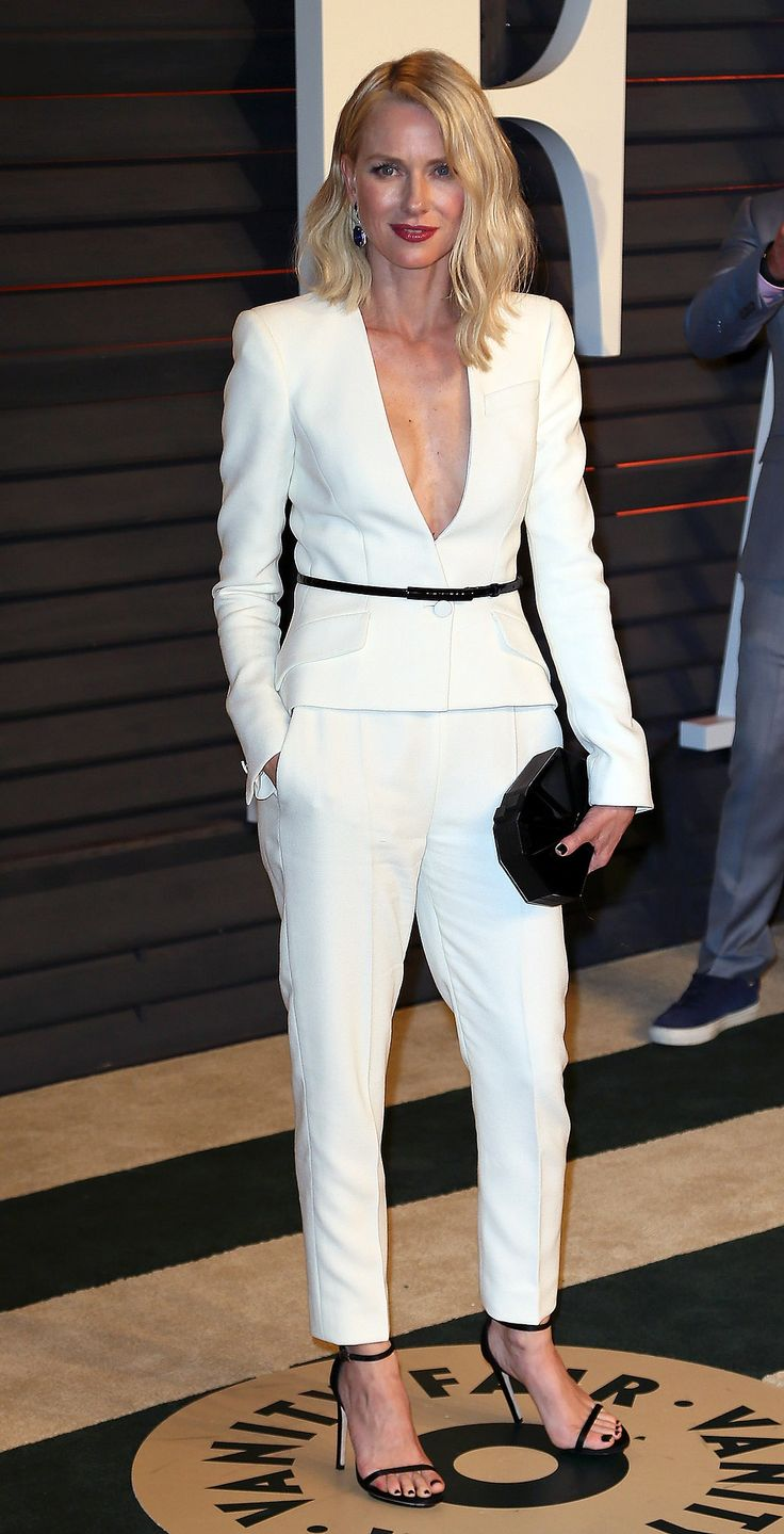 After the Oscars, Naomi Watts hit up the Vanity Fair party in a sleek, white Armani suit. The actress opted for strappy black accents including a skinny belt and sandals.