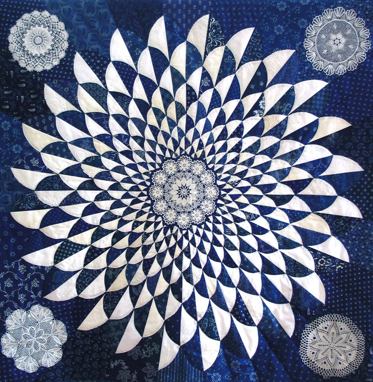 A Quilt using kekfesto cloth and lace appliques in the corners