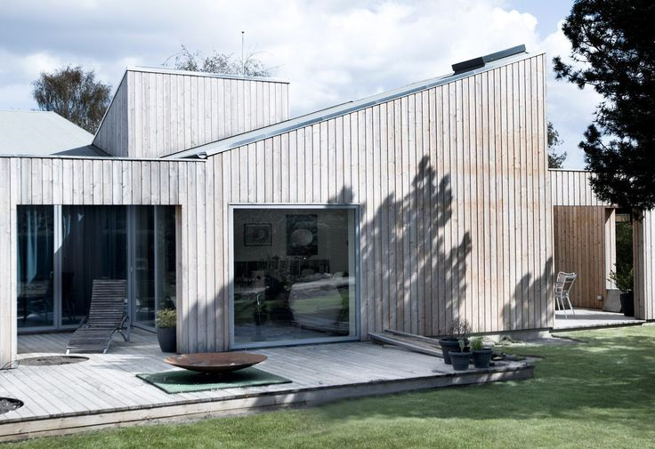 Sigurd Larsen's Roof House features intersecting slanted roofs