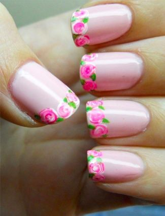 Play with the French tip trend by painting roses along the edges