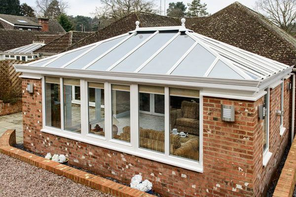 An Edwardian style orangery, functioning as a beautiful living room with…