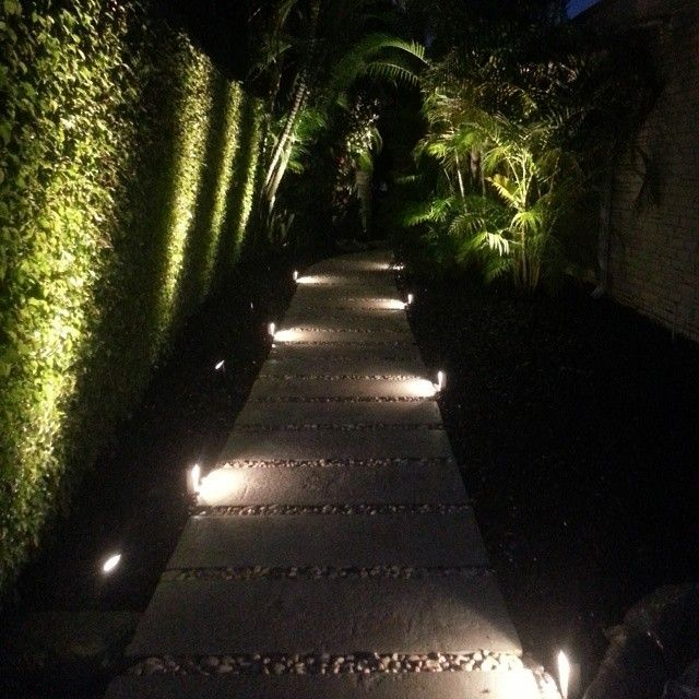 outdoor lighting on the path, on the pavement and on the grass wall