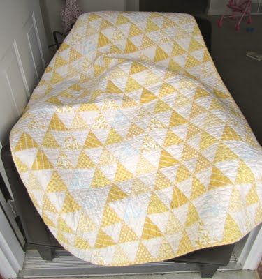 Yellow triangle quilt.  looks antique - so soft and lovely.  Definitely doing this!