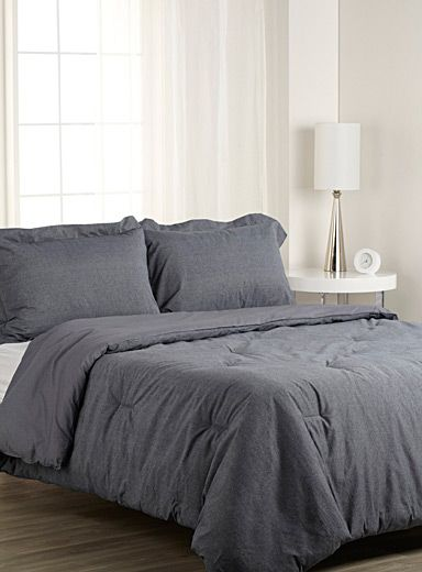 """Exclusively from Simons Maison   An ultra versatile classic that can be used both in the children's room and for an urban loft ambiance. Made of solid, denim-like 100% cotton percale.  Duvet cover set also available.   The set includes:   Twin: 1 comforter 66"""" x 90"""", 1 pillow sham 20"""" x 26"""" Double: 1 comforter 84"""" x 90"""", 2 pillow shams 20"""" x 26"""" Queen: 1 comforter 90"""" x 95"""", 2 pillow shams 20"""" x 30"""" King: 1 comforter 108"""" x 95"""", 2 pillow shams 20"""" x 36""""   *Home decor shown is for…"""
