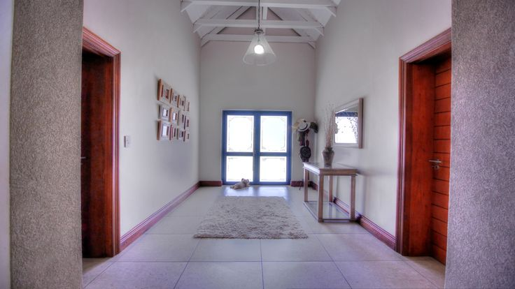 Tasteful entrance area with staircase and tiled floors.