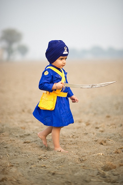 Swashbuckler - Two-year old Raza Singh exhibits the colors of the Khalsa in Punjab, India.