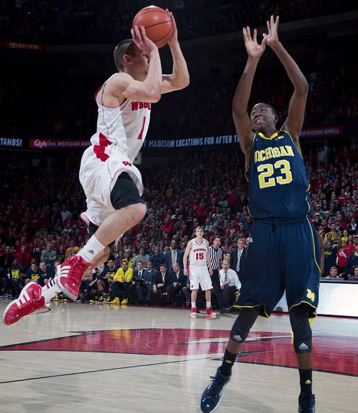 Ben Brust's buzzer-beating 3-pointer sent the game into overtime as Wisconsin Men's Basketball upset No. 3 Michigan at the Kohl Center 2.9.13