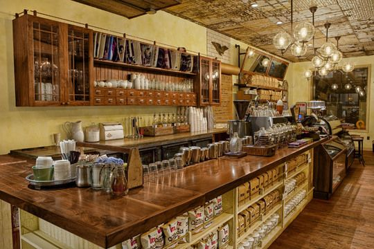 I love everything about this coffee house! I want to own one just like it! The bar top and wall cabinetry were handcrafted.