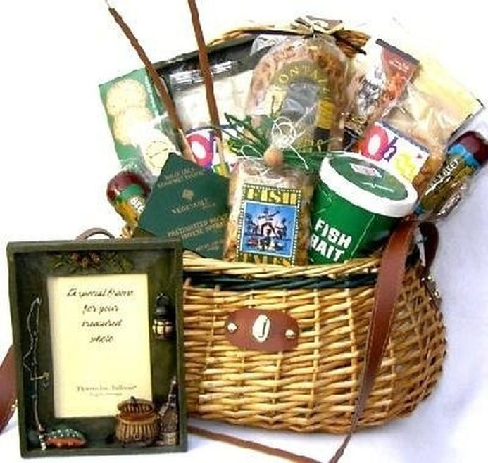 This fishing gift basket is a whopper! This large fishing creel is piled high with everything any self-respecting fisherman or fisher-woman could ever need. Well, less the fishing poles, lures, hooks,
