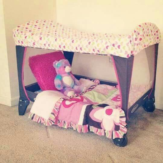 Remove one of the side walls of a playpen to make a bed for your kids, add a fitted mattress cover sheet over top to make it a covered bed.