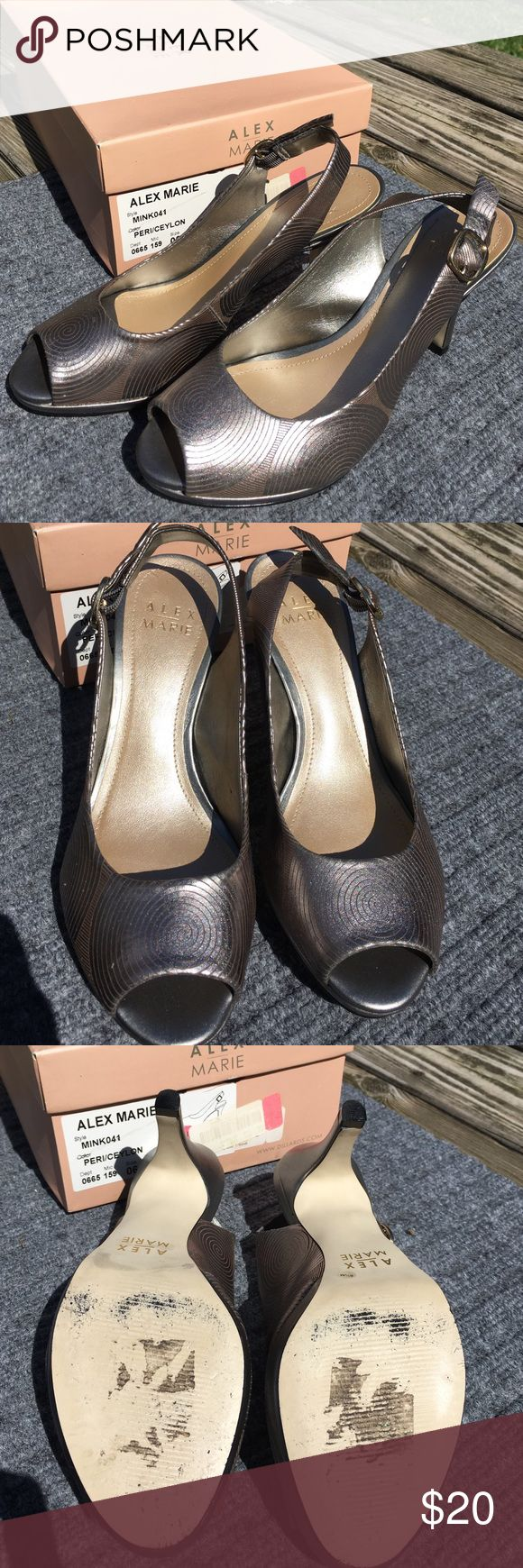 Alex Marie sling back open toe shoes 6.5 These are a pair of shoes from Alex Marie, size 6.5. They were only worn once and only have a few small marks near the toes but they are not too noticeable. They are silver with gold swirls. Alex Marie Shoes Heels