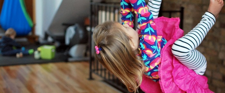 On the rings, swinging, flipping and keeping hair out of her face with a super cute hair clip by ZAZALOO.