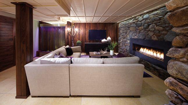 Conception et réalisation du plafond suspendu, design des portes ainsi que le mur en pierre des champs par les designers de chez Pierres et Roches.