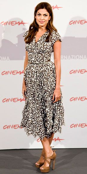Eva Mendes wearing an espresso and white chiffon Oscar de la Renta handkerchief hem dress and patent leather Miu Miu platform sandals.