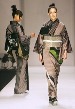 Models display kimonos designed by Japan's Jotaro Saito during Japan Fashion Week in 2007. The traditionally modest and freedom-inhibiting kimono is getting a new lease on life at this year's Japan Fashion Week, with an edge of defiance and seductiveness.