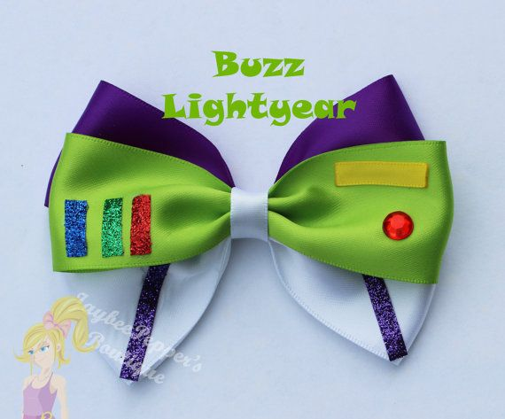 Buzz Lightyear inspired hair bow. Measures about 4.5 across    All bows are made in a smoke free environment and the ends of the bows are heat