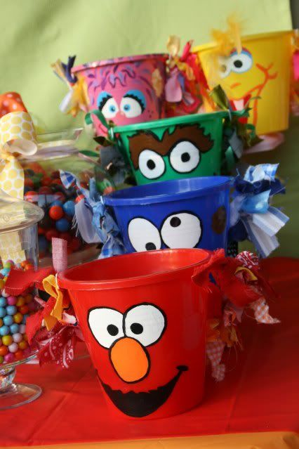 """painted sand buckets/beach pails- to serve food in or for games or for favors. Use the shovels to """"scoop"""" you some treats/snacks."""
