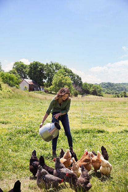 Photo Credit: Squire Fox. Jennifer feeding the chickens.