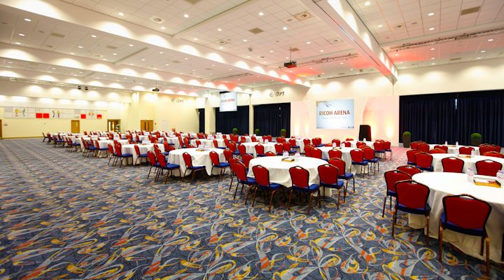 E.ON Lounge - Cabaret style - A versatile, column free room which can easily be separated into three sound proofed sections. Boasting natural daylight, high ceilings, inbuilt AV and a magnificent view of the pitch, the E.ON Lounge is perfect for exhibitions, conferences and gala dinners.