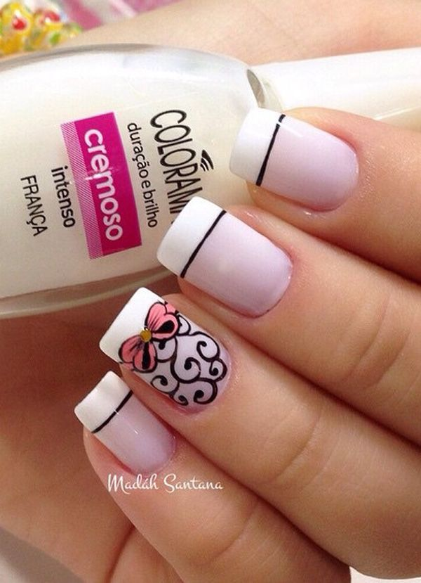 Pretty white and sheer pink French tip with details painted in black polish. Add more drama to your French tips with matching pink ribbons and gold beads on top.
