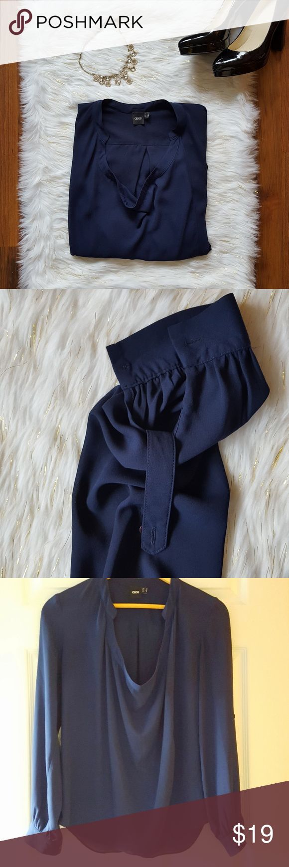 """asos career blouse long-sleeve navy blue size 4 Asos navy blue career blouse size 4. Gorgeous rich blue with convertible sleeves.   Approximate measurements lying flat:  Bust: 19"""" Length:24"""" 100% polyester Smoke-free home   -Reasonable offers welcome, but prices are firm on items under $10.  -No trades, please.  💕💕💕Thank you for shopping my closet, it means a lot to me!💕💕💕 ASOS Tops Blouses"""
