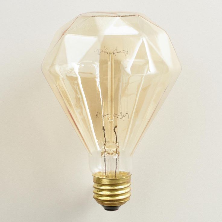 Our vintage-style diamond-shaped filament light shines with a unique amber glow unparalleled by common incandescent bulbs. Pair it with any of our lamp bases or pendants, or hang it with one of our Electrical Cord Swag Kits to add a modern, exposed-bulb flair to your decor.