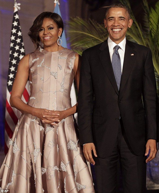 All dolled up: The First Lady attended the event on Wednesday night alongside her husband, President Barack Obama - and the two were later pictured doing the tango with some local dancers