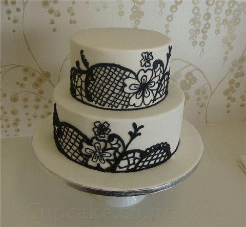 white wedding cake with black lace