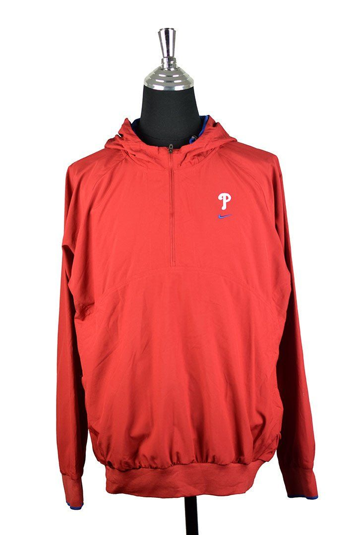 Red Nike Spray Jacket For The MLB Philadelphia Phillies :  Vendor: RetroStar Vintage ClothingType: JacketsPrice: 37.00  Red Nike hooded spray jacket for the MLB Philadelphia Phillies  Partial zipper on collar with hood  Embroidered Nike logo and letter P to front left  Embroidered Phillies logo on hood  Tagged size XL (Do not rely on tagged size. Please check measurements for actual size)  Small marks on arm and cuff (see photo)  Chest: 58cm Length: 68 cm