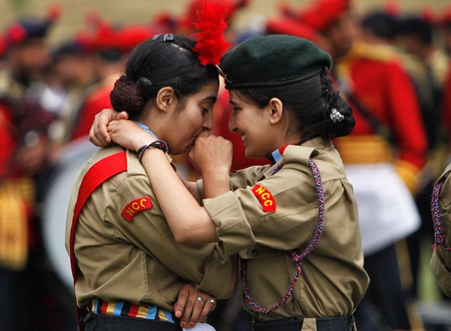 National Cadet Corps (NCC) members embrace during the rehearsal for India's Independence Day celebrations in Srinagar.