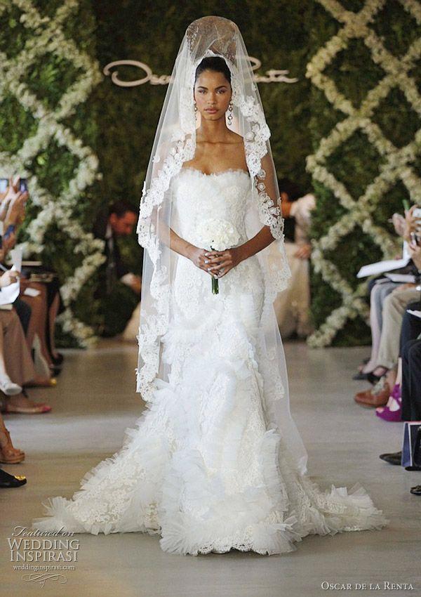 Oscar de la Renta spring 2013 wedding dress; love the Spanish influence!