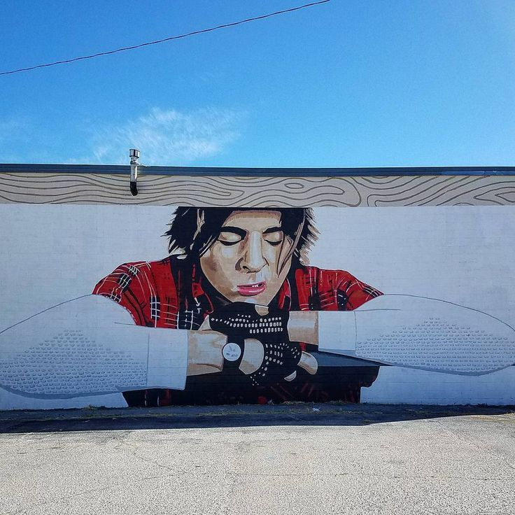 """Greet a film favorite from """"The Breakfast  Club"""" hanging out on the walls of a Lawton, Oklahoma building. John Bender makes a cameo in this larger-than-life mural in tribute of the 1980s cult classic."""
