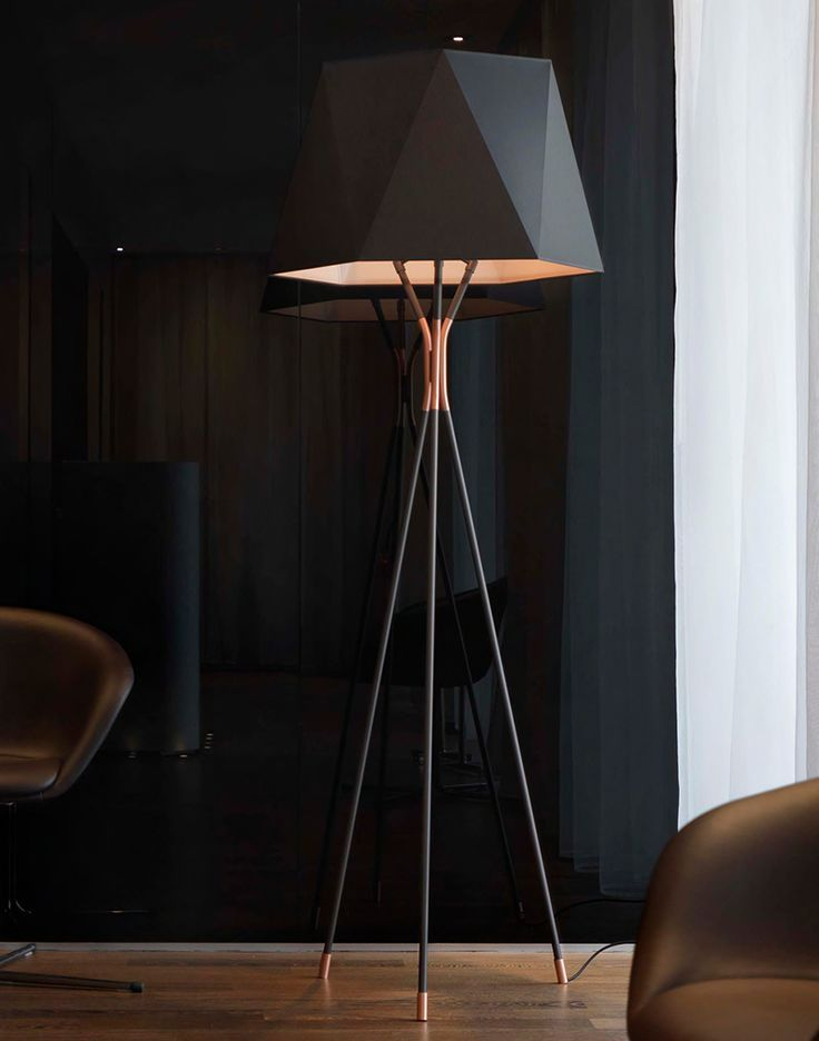 Floor lamp with metal base and shades in white or black fabric available in two
