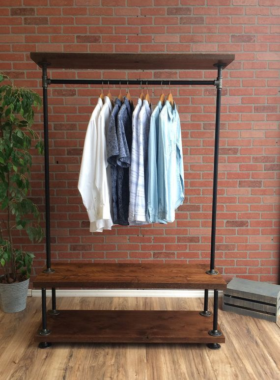 "Industrial Pipe Clothing Rack with Cedar Wood Shelving by William Roberts Vintage  This Industrial Style Vintage Clothing Rack is made to last forever. Using 3/4 black pipe and 3/4 Iron pipe fittings, this heavy duty clothing rack is finished with Rustic Cedar Wood. Our clothing racks are great for use in retail stores or for extra storage in your home.  Features: •¾"" Black Pipe and Fittings •Rustic Cedar Wood •Heavy Duty Design •Industrial Vintage Look •Made in the USA with Global..."
