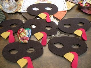 Thanksgiving Masks for a little person party--could be construction paper instead of felt and attached to a straw so kids can hold in front of face instead of strapping on